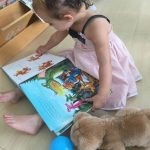 toddler reading at kindergarten