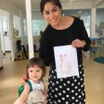 teacher and small child at kindergarten in Bangkok