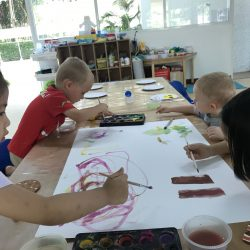 pre-schoolers having fun painting