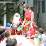 pre-schoolers having fun at Xmas with Santa and their teachers