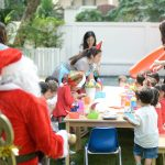 father Christmas over seeing snack time at Bright Skies christmas party at school in Sukhumvit
