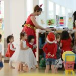 nursery children getting ready for a school christmas party