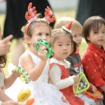 sanat hats and reindeer headbands on pre-schoolers