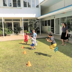 young children playing outside in Bangkok at school