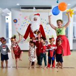 Happy teacher and children during Christmas activities in Bangkok