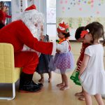 Small children meet Father Christmas during time at kindergarten in Bangkok