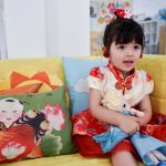 Cute pre-schooler all dressed up for Chinese New Year