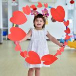 Young girl surrounded by hearts at school