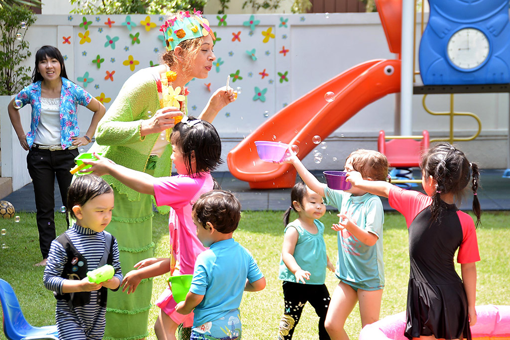 fun with water and bubbles in the garden at Bright Skies International School, Ekamai in Bangkok