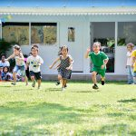 sports day, young children running on the grass
