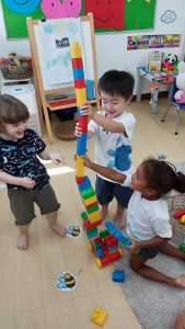 Building a tower with blocks at preschool